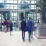 people entering by glass door